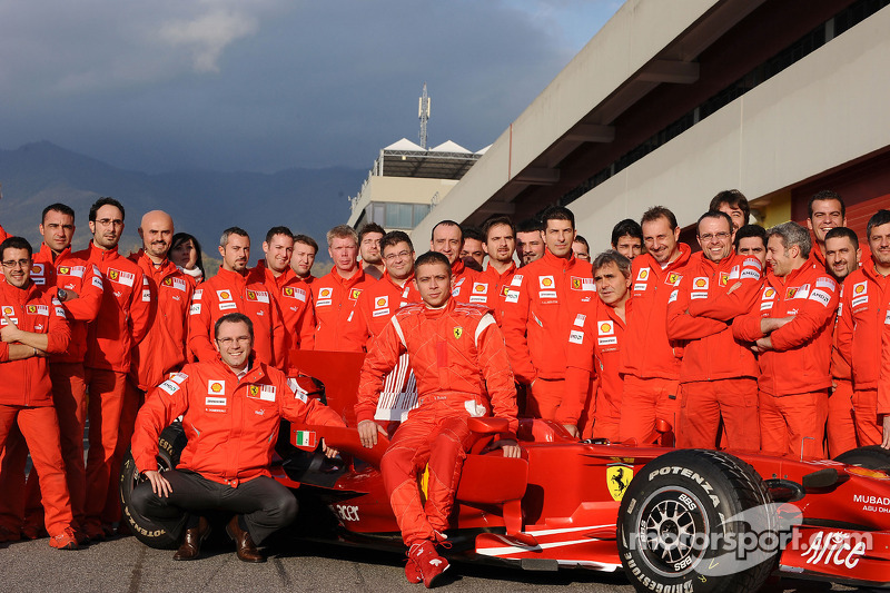 Valentino Rossi with the Ferrari team members at Mugello in 2008