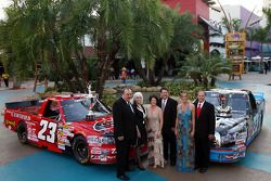 NASCAR Craftsman Truck Series champion owners Bill and Gail Davis, Debbie Benson and husband, NASCAR Craftsman Truck Series champion Johnny Benson, Tanya Hall and No. 23 crew chief Trip Bruce celebrate their 2008 NASCAR Craftsman Truck Series title in the