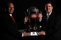 Johnny Benson and crew chief Trip Bruce pose with the 2008 NASCAR Craftsman Truck Series championship trophy