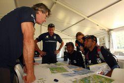 Launceston, Australia: Race director Tim Saul talks to Javith Ababu and Gibson Kemori of team No Roa