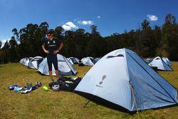 Launceston, Australia: Mark Webber prepares his equipment outside his tent