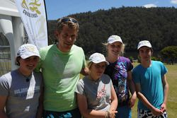Launceston, Australia: David Crawshay poses with children from Devonport High School