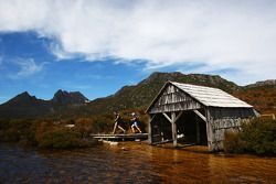 Launceston, Australia: Mark Webber and Emma Weitnauer run past the boat shed on their way to Cradle