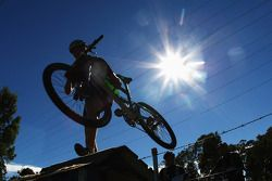 Launceston, Australia: a competitors lifts his bike over a ramp