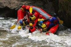Launceston, Australia: a team of rafters crash into the water