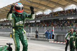 Race winner Adam Carroll celebrates