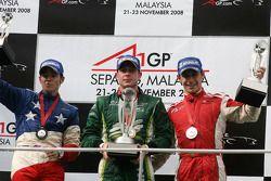 Podium: race winner Adam Carroll, second place Filipe Albuquerque, third place Marco Andretti