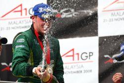 Podium: race winner Adam Carroll