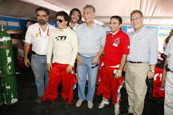 Esteban Tuero and Gaston Mazzacane pose with Stéphane Ratel and VIPs
