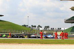 Felipe Guimaraes, Narain Karthikeyan and Marco Andretti crash aftermath