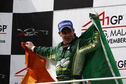 Podium: race winner Adam Carroll celebrates