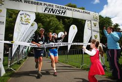 Hobart, Australia: Emma Weitnauer of Mountain designs is greeted by her children as she crosses the finish line