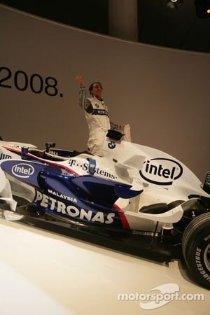 BMW Sauber F1 Team driver Robert Kubica with the BMW Sauber F1 car