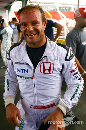 Rubens Barrichello celebrates win