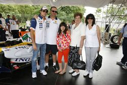 Nelson A. Piquet poses with friends