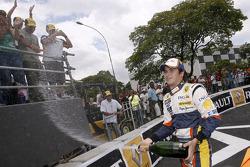 Nelson A. Piquet celebrates after his run