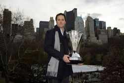 Jimmie Johnson poses with the NASCAR Sprint Cup Series trophy in Central Park in front of the New Yo