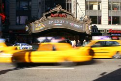 Taxis race through Times Square in New York City Wednesday in front of the Hard Rock Cafe's marquee