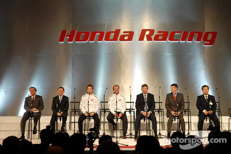 Honda President and CEO Takeo Fukui on stage with Jenson Button, Rubens Barrichello, Ross Brawn, Nic
