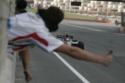 Kamui Kobayashi crosses the line to take victory