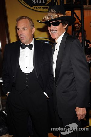 Actor Kevin Costner and past NASCAR Champion Richard Petty pose for photographers before attending the NASCAR Sprint Cup Series Awards Ceremony at the Waldorf=Astoria