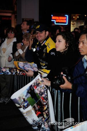 Fans wait for the top 12 NASCAR Sprint Cup Series drivers to depart the Hard Rock Cafe in Times Squa