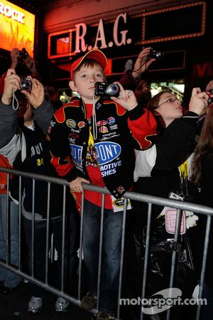 A young Jeff Gordon fan, among other fans, takes pictures outside of the Hard Rock Cafe in Times Square