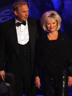 Actor Kevin Costner accompanies NASCAR Assistant Secretary and International Community Relations Director Betty Jane France onstage