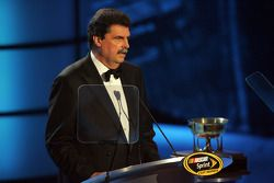 President of NASCAR Mike Helton introduces car owner Rick Hendrick during the NASCAR Sprint Cup Series Awards Ceremony at the Waldorf=Astoria