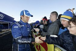 Petter Solberg greets his hoards of fans outside the SWRT service area