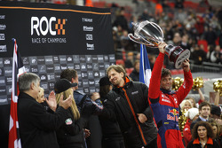 Podium: Race of Champions winner Sébastien Loeb lifts the winner's trophy