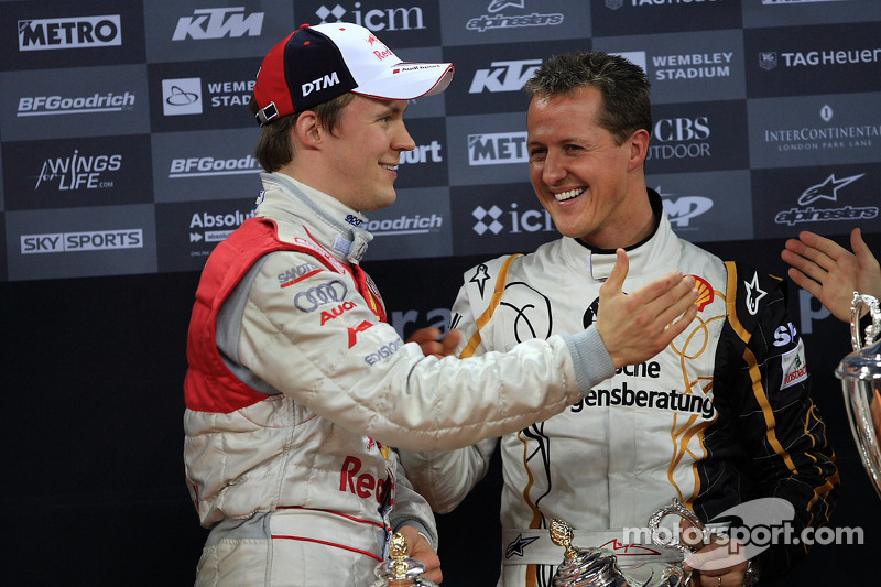 Podium: Michael Schumacher and Mattias Ekström