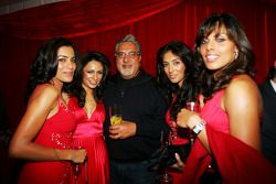 Dr Vijay Mallya Force India F1 Team Owner with the Fly Kingfisher Girls at the Fly Kingfisher Boat P