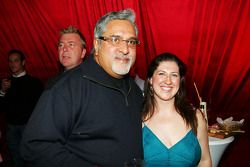 Dr Vijay Mallya Force India F1 Team Owner with Lucy Nell Force India F1 Team Press Officer at the Fl