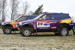 X-raid team: the #302 BMW X3 CC of Nasser Al Attiyah and Tina Thorner, the #318 BMW X3 CC of Peter van Merksteijn and Eddy Chevaillier