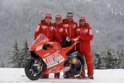 Nicky Hayden, Casey Stoner, Livio Suppo and Vittoriano Guareschi with the new Ducati Desmosedici GP9
