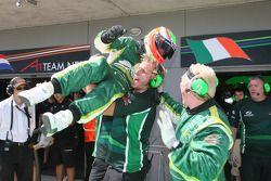 Adam Carroll celebrates pole position