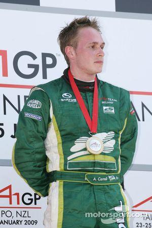 Podium: winner Adam Carroll
