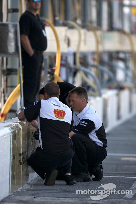 Penske Racing team members prepare pit area