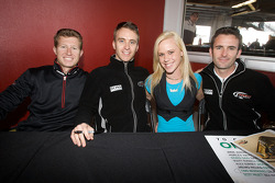 Ryan Briscoe, Timo Bernhard and Romain Dumas with a cute fan