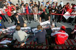 Hamad Al Fardan, Vitaly Petrov, Giedo Van der Garde and Earl Bamber sign autographs for fans