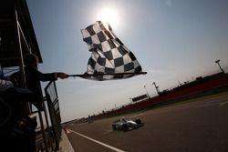 Sergio Perez takes the checkered flag to win the race