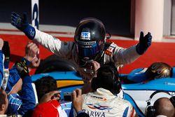 Sergio Perez celebrates winning in park ferme