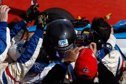 Sergio Perez celebrates winning in the paddock