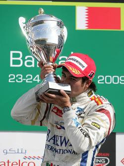 Sergio Perez celebrates winning on the podium