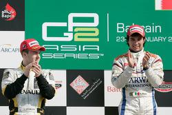 Sergio Perez celebrates his victory on the podium with Davide Valsecchi