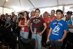 Chip Ganassi Racing team members and guests watch the end of the race