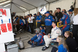 JC France and Brumos Racing team members watch the end of the race