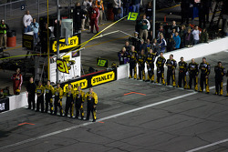 Crew members align during National Anthem