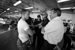 A.J. Allmendinger, Richard Petty Motorsports Dodge, talks with crew members
